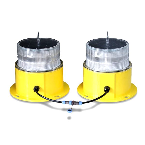 pair of yellow solar powered obstruction light