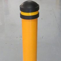 black capped yellow bollard